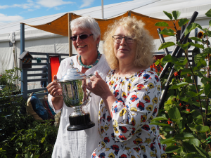The Mike Hough memorial trophy held by Carol and Chris