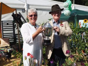The Mike Hough memorial trophy held by Carol and Simon